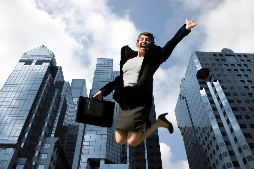 jumping_businesswoman_downtown.jpg
